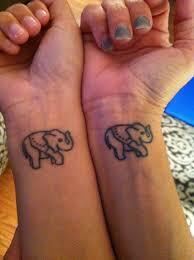 me and my mom u0027s matching elephant tattoos on our wrists