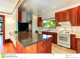 kitchen cabinets with granite tops and white appliances stock