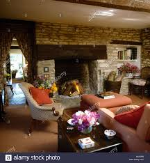 inglenook fireplace in country cottage livingroom with stone wall