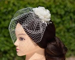small birdcage veil with cherry blossom in ivory bridal hair