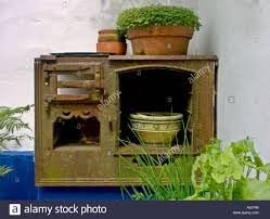 the remains of an old cornish range cooker in the corner of a