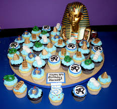 egyptian cupcake display with mummies snakes pharaohs eye of