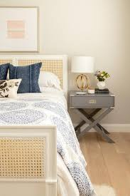 gray campaign nightstand with gold sphere lamp transitional