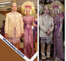 formal indonesian wedding photographs in which the bride wears the