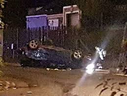 man left trapped in overturned car as two passengers flee serious