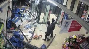 siege social aldi footage shows ram raid on aldi store as machine is