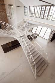 What Is Loft by Smartvoll Adds Sculptural Concrete Staircase To Loft Apartment In
