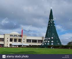 a 20 feet christmas tree made of recycled materials is seen on the