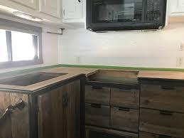 black stain on kitchen cabinets diy black kitchen countertops mountain modern