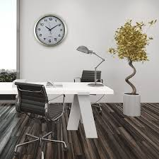 hall oversized wall clocks with brown wooden floor and white wall