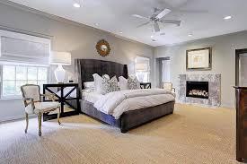 dark gray velvet wingback bed with black mirrored nightstands