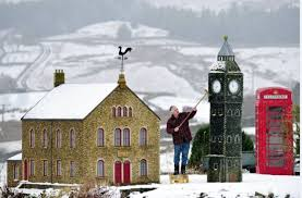 a pensioner has built three miniature villages in his back garden