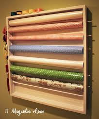diy wall mounted wrapping station in craft room 11 magnolia