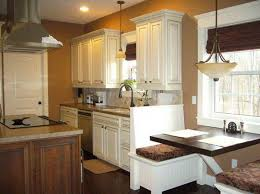 top kitchen color ideas white cabinets wooden floor brown wall