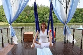 female aerial yoga relaxingin a hammock stock photo colourbox