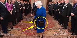 queen handbag queen elizabeth ii owns 200 of the same handbag business insider