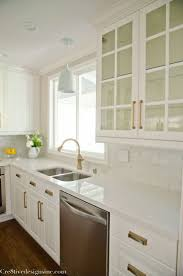 granite countertop white and green cabinets backsplash how to