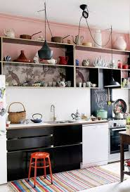 eclectic kitchen style with pendant lights and black cabinets and