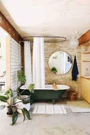 bathroom with houseplants and round mirror also forest green