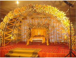 mehendi function decor ideas with yellow flowers weddings