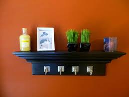 White Bathroom Shelf With Hooks by Bathroom Likable Wall Shelf Hooks Design Drawers And Shelves