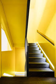 Col House by Naturehumaine Adds Black And Yellow Staircase To Montreal Home