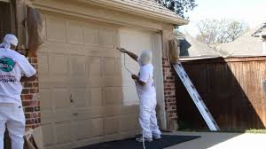 spray painting exterior of house home painting