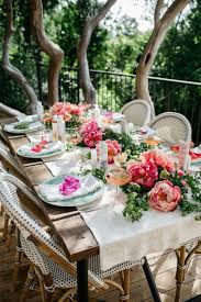 decorative flowers and classic wicker chairs for summer backyard