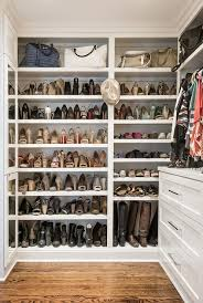 small walk in closet with built in shoe shelves transitional