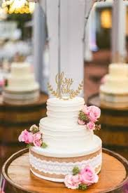 white textured buttercream wedding cake with gold bands jewish