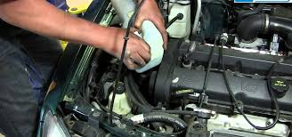 how to replace a broken windshield washer pump on your 1998 03