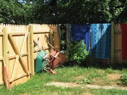 natural backyard garden with decorative green menard snow fence