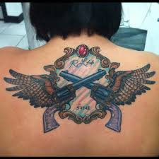 pistols guns wings tattoo by nate johnson tattoos