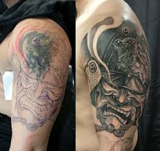 tattoo cover up on black skin half sleeve black and grey samurai helmet cover up tattoo chronic ink