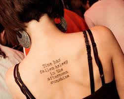 inspiring quote on the back tattoomagz