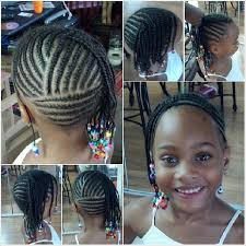 young black american women hair style corn row based love the design in the back multidirectional cornrows updo for