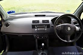 nissan sunny 2002 interior feature the proton iriz revisited how does the iriz stack up