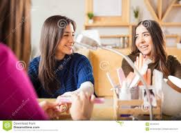 female friends hanging out at a nail salon stock photo image