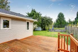 picture of large wooden back deck house exterior there is a