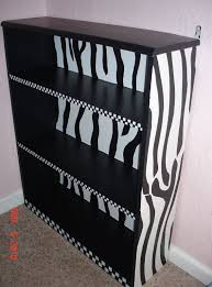 i need to do something similar to the girls bookshelves maybe this would be cute in ariannas zebra room