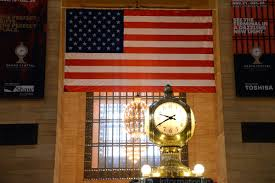 Flag Of New York City 08 2 Clock With American Flag Behind In New York City Grand