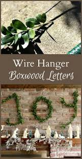 wire hanger boxwood letters for a joyful holiday mantel wire