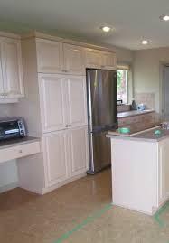kitchen island wall cabinets concrete flooring faded cork floor bottom mount freezer stainless