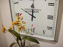 Small Bathroom Clock - sleek polished nickel wall clock adds transitional elegance with