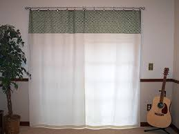 draw drapes sliding glass doors curtains over vertical blinds