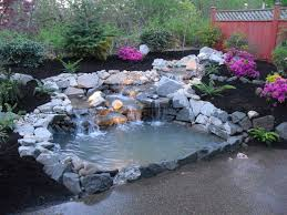 backyard pond ideas that are beautified with inexpensive waterfall