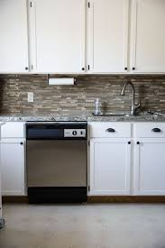 best 25 painting oak cabinets white ideas on pinterest painted our 281 diy kitchen remodel diy painting oak cabinets white adding wood trim to