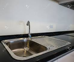 Kitchen Sink Black Granite by Bowl Stainless Steel Kitchen Sink On A Black Granite Worktop Stock