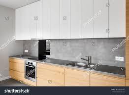 modern kitchen furniture contemporary kitchenware like stock photo