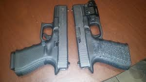 glock 19 light and laser our two glock 19 gen 4s one with viridian green laser flash light